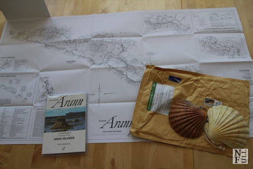 Map, guidebook and shells