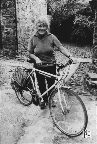 Dervla & bike, 1994 by John Minihan