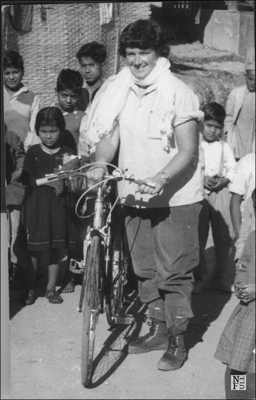 Dervla, her bike and some locals.