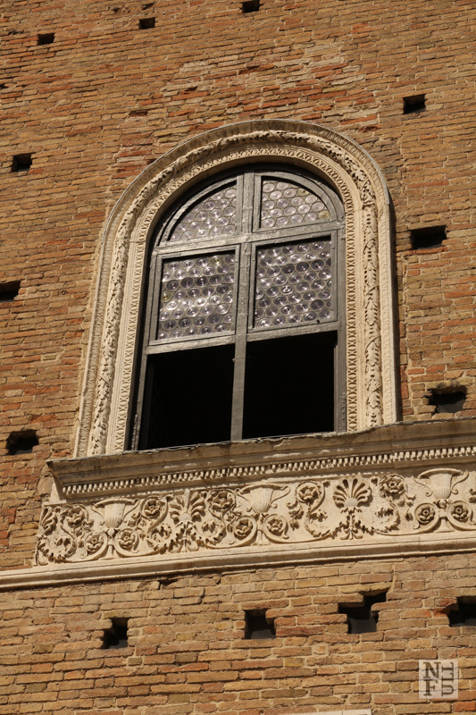 A Renaissance window of Palazzo Ducale, Urbino, Marche, Italy