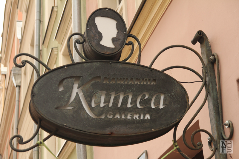 Elegant sign of Kamea Cafe, Poznan, Poland