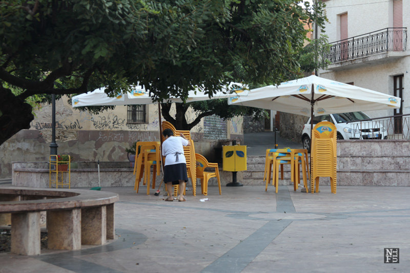 Cleaning of the main square in early morning, Fluminimaggiore, Sardinia, Italy.