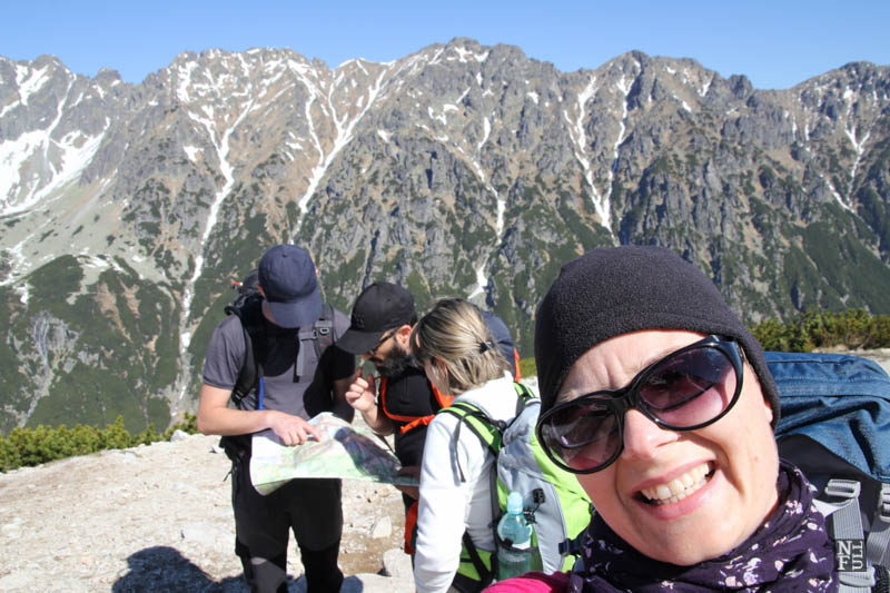 Looking at the map. Tatry, Poland.